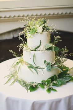 a #DIY wedding #cake topped with greenery Photography by ebersolephotography.com/  Read more - http://www.stylemepretty.com/2013/09/18/lenox-massachusetts-wedding-from-ebersole-photography/