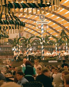 """Munich's Top 10 : Beer Gardens - Hirschgarten    Munich's largest beer garden – which features deer in an enclosure after which the beer garden is named – lies near Nymphenburg Palace. The golden Augustiner brews flow from a huge """"stag"""" barrel."""