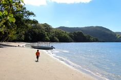 Little boy walking on Viani Bay in Fiji