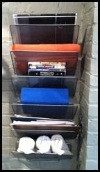 From the office to the gym. I desperately needed some organization in our gym. With the DVD's, yoga equipment and clipboards everywhere it was hard to concentrate on my workouts. Thankfully…once again…the Container Store came to my rescue!