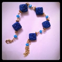 Bracelet Carved cinnabar, carved gold plate spacers, blue glass beads, gold plate chain. Jewelry Bracelets