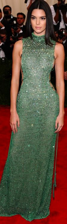 Kendall Jenner rocked a green crystal gown by Calvin Klein on the red carpet of this year's MetGala 2015. it comes as no surprise to see the supermodel in one of CK creative director Francisco Costa's creations. Jewelry by Chopard.