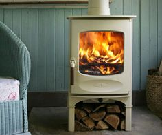 C-Four Wood Stove, by Charnwood.  a white wood stove, now there's an idea.