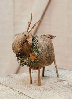 Made of soft fabric, Reindeer Ornament has stick legs and antlers, as well as a wreath around its neck. Measures 6½inches high and 6inches wide.                                                                                                                                                                                 More
