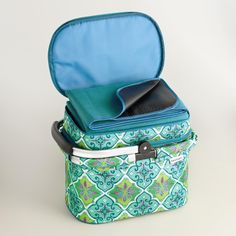 Perfect for picnics, the beach, camping trips and other outdoor events, our exclusive tote features a roomy bottom deck with an insulated lining, an upper deck that stores an included blanket, and our colorful geometric design.