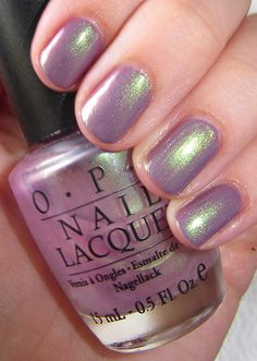 OPI - Significant Other Color, shown over OPI Parlez-Vous OPI?, purple sheer base with electric green shimmer, similar to Zoya Adina, swtached on one hand, $7