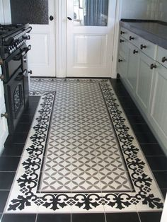Wohnen Kitchen floor with cement tiles in black, gray and white from OSM How to Carry a Ladder Corre Entryway Flooring, Hall Flooring, Flooring For Stairs, Kitchen Flooring, Hall Tiles, Tiled Hallway, Patio Tiles, Outdoor Tiles, Floor Design