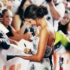 Nina Dobrev signing autographs!