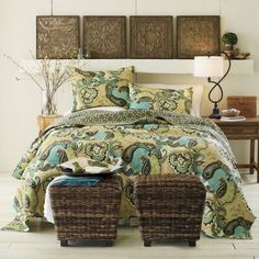 Love the turquoise and green bedding with the dark brown accents.