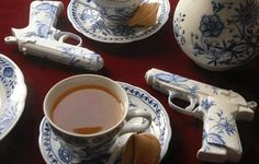 The Porcelain Pistols are replicas of James Bond's. The fragile weapon handpainted as classic tableware motifs lies next to your coffee and cake. coolness and comfortable a quandary between the pleasure of luxury and violence.  By Yvonne Lee Schultz