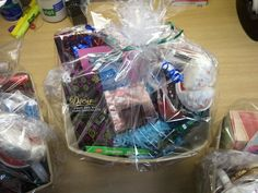 Chocolate Gift Baskets: Storage basket, small cardboard box for height, shredded color paper, variety of chocolate, heart mug and chocolate candle. Cellophane and ribbon to wrap :)