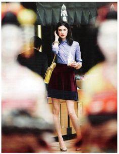 button shirt, skirt, yellow structured bag.