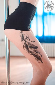 Pretty Feathers Thigh Tattoo