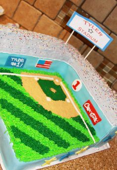 """Tyler Stadium - Made from (3) 8"""" square chocolate cakes, trimmed in fondant, rest is Buttercream. Personalized with Tyler's name and his age: #1!   Baseball smash cake. TFL"""