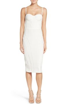 Molded bustier cups with contoured ladder trim sculpt a figure-flaunting silhouette in this chic midi cocktail dress crafted from luxurious bright white silk.