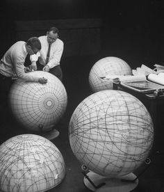 US Scientists study the phases of the moon on lunar models in preparation for an eventual manned flight to the moon — 1962.