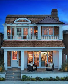 This cozy cottage is perfectly suited for the beach.. with the front porch and the cedar shakes, the details are perfect.