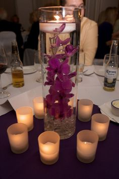 purple centerpiece with candles purple flowers