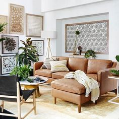 neutral living room with leather couch, gold and white pedestal coffee table and plants My Living Room, Home And Living, Living Room Furniture, Living Room Decor, Living Room Ideas Tan Sofa, Small Living, Leather Sectional Sofas, West Elm Sectional, Modern Sectional