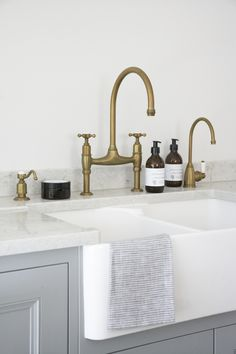 Scullery run with aged brass Perrin & Rowe taps. A soap dispenser, Ionian deck mounted tap and Parthian hot water tap installed in a beautiful Longford kitchen. kitchen accessories HM Antique Brass Taps - By Perrin & Rowe Kitchen Hardware, Kitchen Fixtures, Kitchen Faucets, Antique Brass Kitchen Faucet, Sink Faucets, Brass Kitchen Handles, Brass Bathroom Fixtures, Kitchen Sink Decor, Plumbing Fixtures
