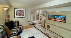 Seating room with view of wall unit that I designed a few years back with fish tank artwork, painted on glass.