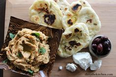 A Game of Thrones inspired dish. Prince Doran's afternoon meal of freshly made hummus, warm flatbread, kalamata olives and goat cheese. #gameofthrones #dirtythekitchen