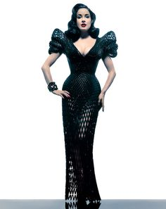 Dita Von Teese debuted a 3D printed dress, designed by Michael Schmidt (of Lady Gaga bubble dress fame) and generated by architect Francis Bitonti, last week at the Ace Hotel. It premiered during a showcase of 3D products hosted by digital printing marketplace, Shapeways. Although we have seen 3D printed fashions before, this is the first be a fully motile, fluid, curve-hugging dress.