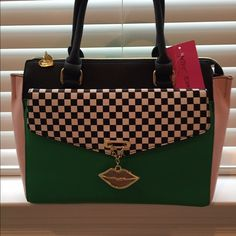 Lowest price!. Until midnight. Betsy Johnson Gorgeous Betsy Johnson purse. Has a shoulder strap. Beautiful colors. NWT Betsey Johnson Bags Shoulder Bags