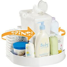"""The Spin Changing Station: Store all the essentials needed in one unit that conveniently spins for easy access. The 14"""" diameter caddy stores diapers, full size lotion and powder, creams, andhas a wipes container stand in the center..."""