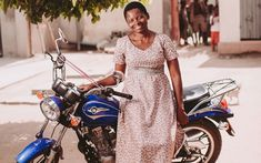 09ec1d2d7a3d Komina stands in front of her motorbike Compassion International, Photos Of  The Week, Motorbikes