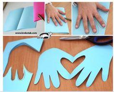 Deux mains, des ciseaux, un coeur, une déco.