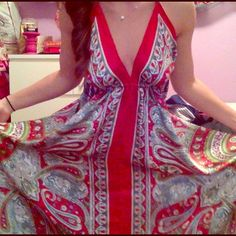 Sexy red dress NWOT Halter top, tie back, long high low in the front, great summer dress on the beach! Sorry about the messy room in the last picture!! Dresses Backless