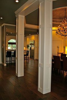 formal dining rooms with columns. dining room open to kitchen; structural columns formal rooms with h