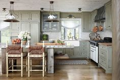 I love love love this kitchen!   pretty colour for the cabinets too