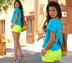Blue open-back w/ neon shorts. Neon Shorts, Yellow Shorts, Bright Shorts, Black Shorts, Neon Outfits, Cute Outfits, Fashion Outfits, Fashion Trends, Bright Summer Outfits