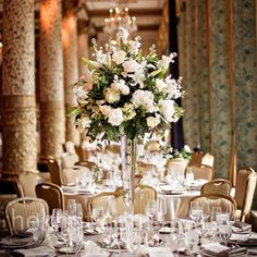 Tall arrangements of white flowers and greenery topped the dinner tables.