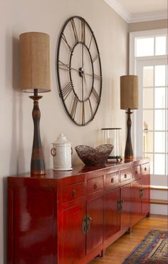 eclectic mix - modern oversized wall clock, Chinese lacquer sideboard/credenza, African-inspired lamps