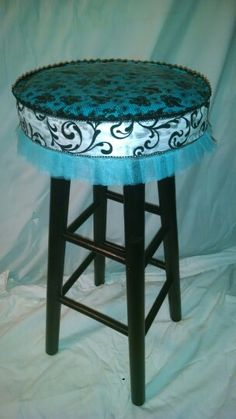 Painted the legs on this old wooden bar-stool black, duct-tape on the very top, then trimmed the outside with a few different laces.....