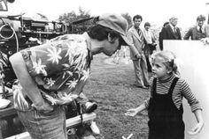 Director Steven Spielberg and actress Drew Barrymore discuss an upcoming scene during the filming of E.T.: THE EXTRA-TERRESTRIAL.