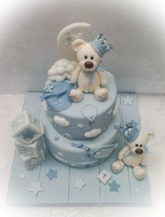 Originally mum sent me a picture of a cake by the brilliant Poppy Pickering, which was itself inspired by another bear cake. I wanted to add my own twist to the very popular bears, clouds, crowns and crescent moon cake idea. So, taking inspiration. Gateau Baby Shower, Baby Shower Cakes, Baby Boy Cakes, Cakes For Boys, Beautiful Cakes, Amazing Cakes, Christening Cake Boy, Teddy Bear Cakes, Novelty Cakes