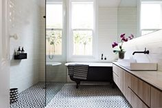 graphic floor, black cast iron tub, contemporary floating vanity