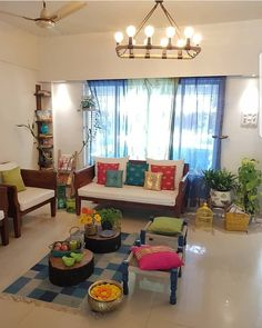 An overview of 's living room. Love the use of bright colours to offset the simple, white upholstery. Indian Living Rooms, Colourful Living Room, My Living Room, India Home Decor, Ethnic Home Decor, Indian Home Design, Indian Home Interior, Indian Interiors, Home Room Design