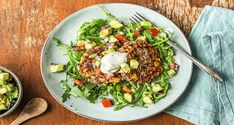 Black beans and corn are the basis for these cakes with a kick. After adding a bit of fiery jalapeño and mashing them to a creamy consistency, you shape the mixture into small patties and crisp them up in a pan. On the side, you've got an arugula salad tossed with balsamic and an avocado tomato salsa that's essentially a chunkier, funkier form of guacamole.