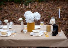 white christmas table setting with mustard yellow detail