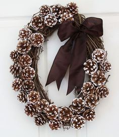 Winter wreath that isn't Christmas-y Like to oval and like the brown bow with frosted tip pine cones. Look for pine cones. Dishfunctional Designs: Decorating & Crafting With Pine Cones Pine Cone Crafts, Wreath Crafts, Diy Wreath, Wreath Ideas, Grapevine Wreath, Door Wreaths, Pine Cone Wreath, Acorn Wreath, Ribbon Wreaths