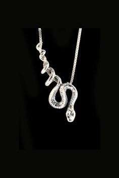 This sinuous Python Snake winds gracefully along and down the chain as if it were suspended from a vine. The solid sterling snake is 2 1/4 long and