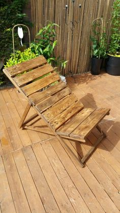 Alternative reclaimed timber deck chair finished in dark wax