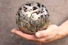Who doesn't have a bunch of old keys that belong to objects they no longer own? Here's a creative Aussie's conversion of old keys into art. Small key ball sphere metal sculpture ornament by Moerkey, $105.00
