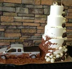 Soooooo doing this for grooms came but with a lifted truck on big wheels and a smaller more interesting cake.