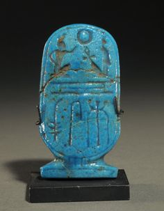 Front; Cartouche of Ramesses IX Circa. 1120 to 1077 B.C.  Measurements; h. 6.40 cm.  Materials; faience and clay glaze constituents.   Information; This cartouche is finely incised with his name. He was the eighth King of the XXth Dynasty and ruled from 1129 to 1111 B.C. This cartouche was part of the J.M.E. collection, New York.  Reference; RA1407 COPYRIGHT © Royal Athena
